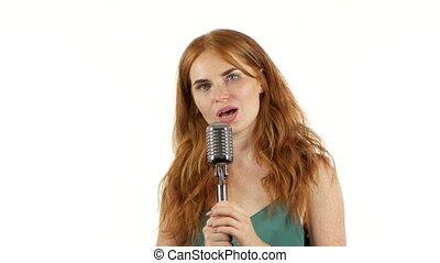 Girl with freckles sings in a retro microphone. White background