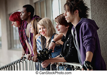 Girl with Friends Looks at Camera