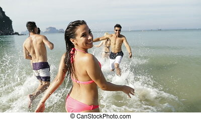 Girl With Friends Running In Water Calling You To Join,...