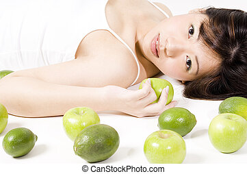 Girl With Fruit 1 - A beautiful young asian woman in white...
