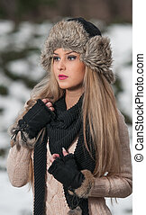 Girl with fur cap in winter