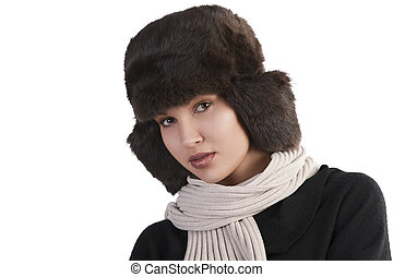 girl with fur hat and with scarf looking at the camera