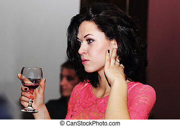 girl with glass of wine at a party