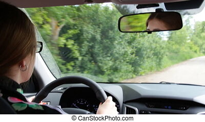 Girl with glasses at the wheel