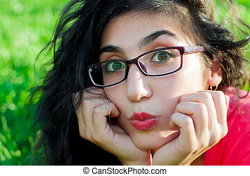 girl with glasses in the park
