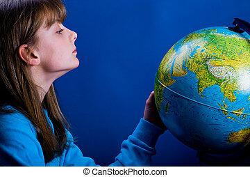 Girl with globe