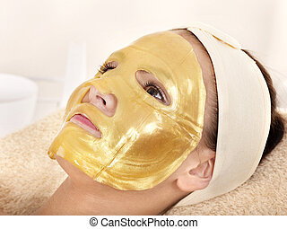 Girl with gold facial mask. - Young womanl with gold facial...