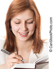 girl with golden hair makes notes on a pad