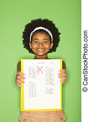 Girl with good grade. - African American girl holding out...