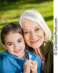 Girl With Grandmother At Campsite
