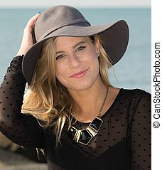 Girl with gray hat