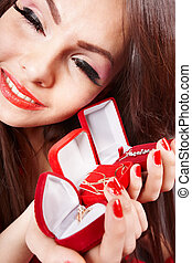 Girl with group jewelery box on red background. Valentines day.