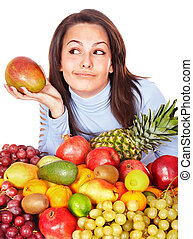 Girl with group of fruit and vegetables.