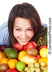 Girl with group of fruit.
