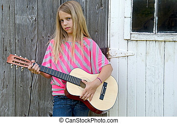 girl with guitar by barn
