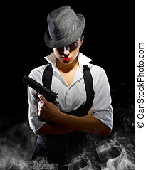 Girl with gun and hat