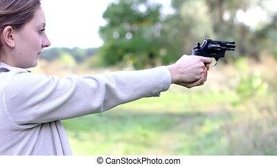 Girl with gun - Girl shoots a gun
