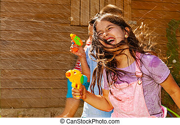 Girl with hair on face play water gun fight game