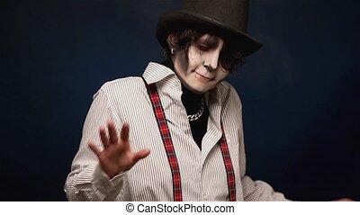 Girl with Halloween makeup dancing in studio