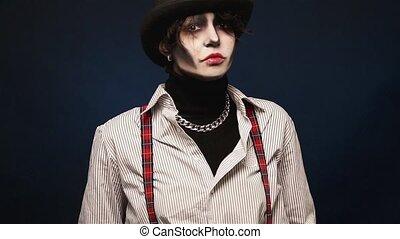 Girl with Halloween makeup posing in studio