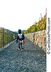girl with Halloween pumpkin Jack O'Lantern basket