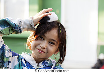 girl with hamster on head