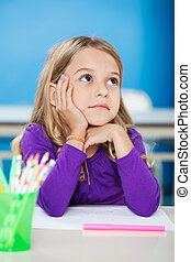 Girl With Hand On Chin Looking Away In Class