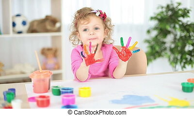 Girl with hand painted in colorful
