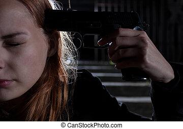 Girl with handgun