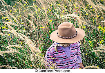 girl with hat in autumn meadow