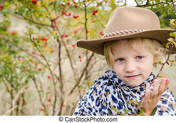 girl with hat in autumn season