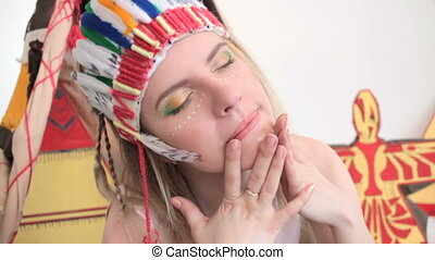 Girl with headband and make-up touching her face