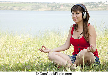 Girl with headphone in the park.