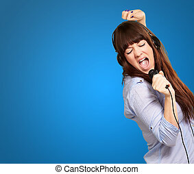 Girl With Headphone Singing On Mike On Blue Background