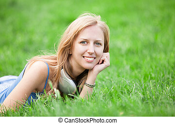 girl with headphones at outdoor