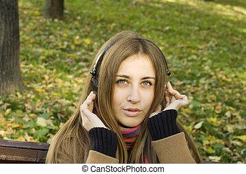 Girl with headphones fall