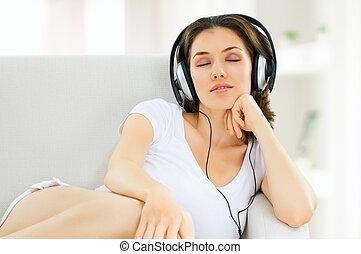 girl with headphones in room
