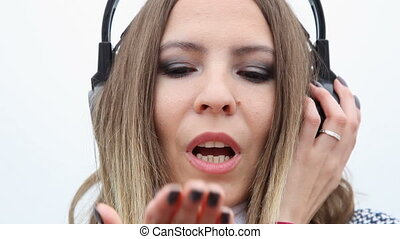 Girl with headphones listening