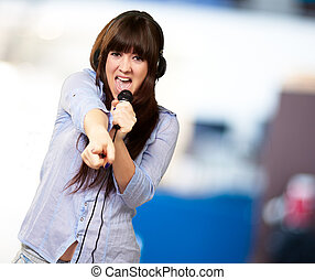 Girl With Headset Singing On Mike, indoor