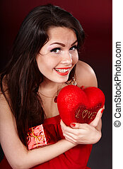 Girl with  heart  and gift box on red  background.