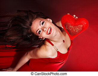 Girl with heart  in red flying. Valentines day.
