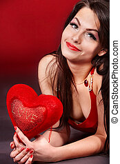 Girl with  heart  on red  background.