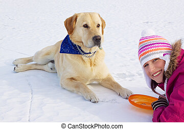 Girl with her dog in winter