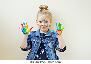 girl with her hands in paint