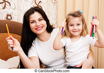 Girl with her mother for drawing.