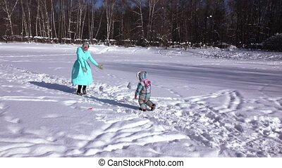 Girl with her mother in the snow