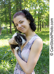girl with her pet rabbit