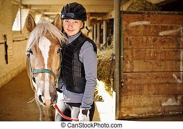Girl with horse - Portrait of teenage girl with horse in...