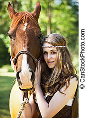 Girl with horse - A portrait of a caucasian girl with her...