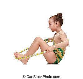 girl with hula hoop doing gymnastics